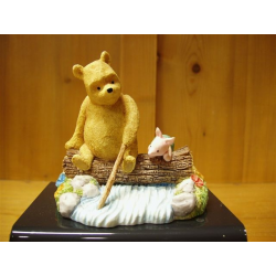 Pooh And Piglet Sitting On A Log